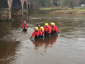 Practical Exercise for the cold water working training course. Wading in the river to understand how powerful the flow can be.